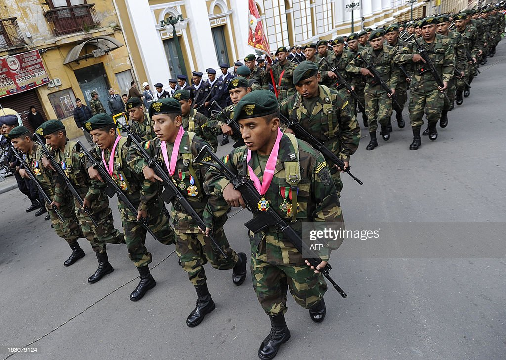 Bolivian soldiers Augusto Cardenas (3-R), Alex Choque (2-R) and Jose Luis Fernandez (R), who were arrested over a month ago in Chile after illegaly trespassing the border whilst in pursuit of car smugglers, parade with their unit after being decorated by Bolivian President Evo Morales, in front of the presidential palace Quemado in La Paz, on March 4, 2013. The three Bolivian soldiers, whose arrest in January had heightened the tense relations between the two South American neighbours, where welcomed in their country last week with military honours.