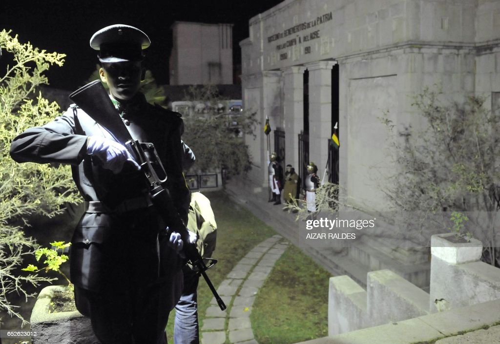 Bolivian soldiers stand guard outside the mausoleum for the Chaco war heroes, at the Municipal cemetery in La Paz, on October 31, 2011, on the eve of All Saints Day. For the first time, the mayor's office opened the cemetery by night to promote it as a tourist point and counteract the growing influence --mainly on residential neighbourhoods-- of Halloween celebrations. AFP PHOTO/Aizar RALDES /