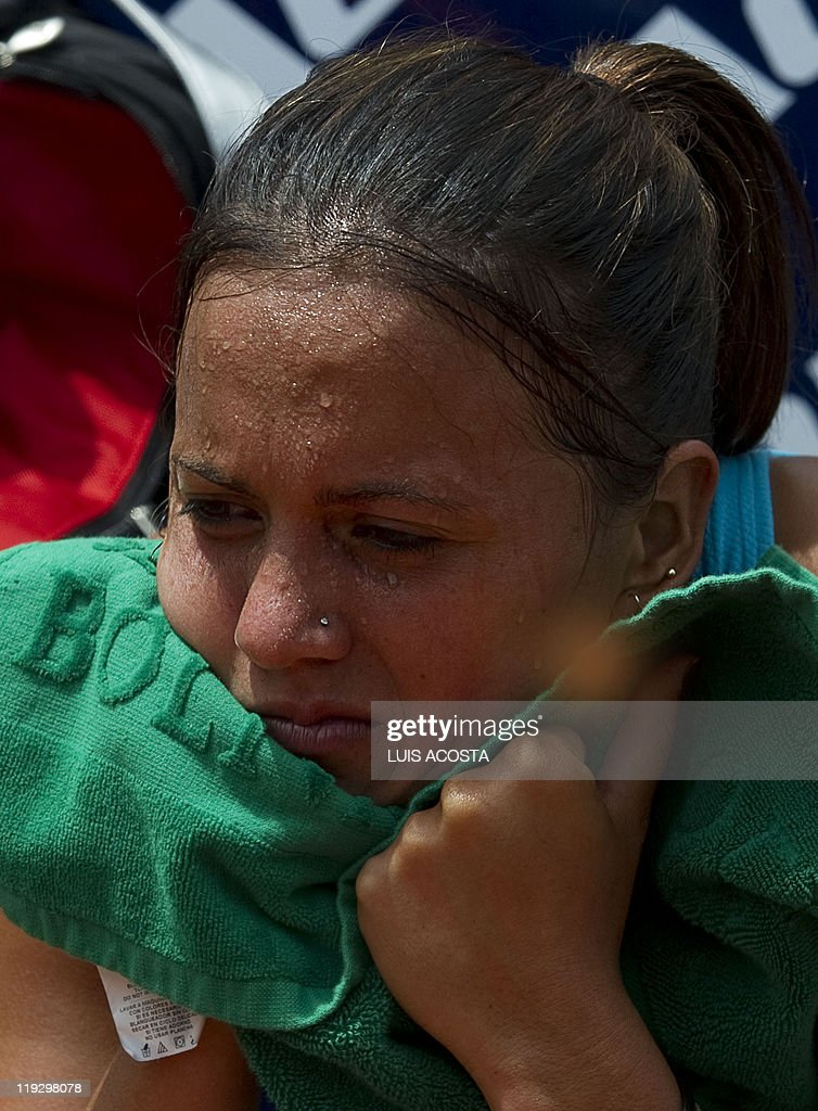 AFP PHOTO/<b>Luis Acosta</b> Show more - bolivian-tennis-player-mia-alvarez-reacts-after-beign-defeated-by-picture-id119298078