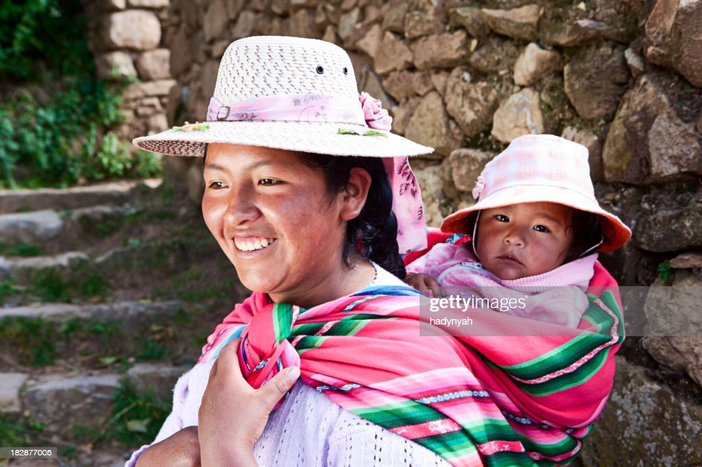 'Bolivian woman carrying her baby, Isla del Sol, Bolivia'