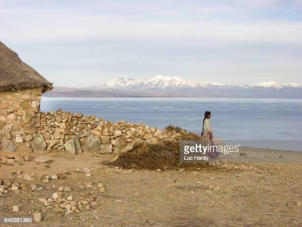 Bolivian woman looking at Lake Titicaca