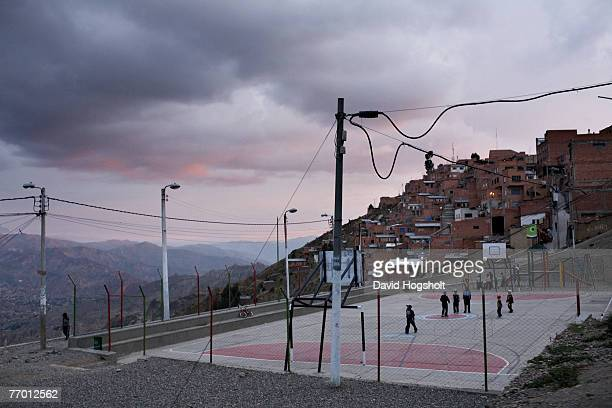 Bolivian youths playing football January 31 2007 in the city of El Alto located on the plateau above La Paz Bolivia El Alto is home to a lot of...