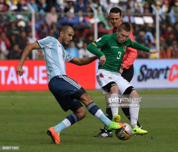Bolivia's Alejandro Chumacero and Argentina's Guido Pizarro vie for the ball during their 2018 FIFA World Cup qualifier football match in La Paz on...