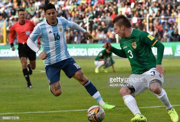 Bolivia's Alejandro Chumacero and Argentina's Marcos Rojo vie for the ball during their 2018 FIFA World Cup qualifier football match in La Paz on...
