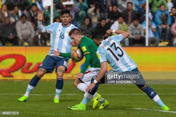 Bolivia's Alejandro Chumacero vies for the ball with Argentina's Marcos Rojo and Argentina's Ramiro Funes Mori during their 2018 FIFA World Cup...