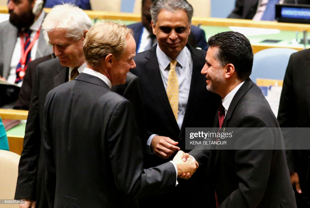 Bolivia's ambassador to the UN, Sacha Llorentis (R) shakes hands with Matthew Rycroft, British Permanent Representative to the United Nations after Bolivia won a seat during the Election of five non-permanent members of the Security Council at the United Nations in New York on June 28 2016. Three European countries and two Asian nations are battling for seats on the UN Security Council in elections that are drawing attention to the refugee crisis and human rights. / AFP / KENA