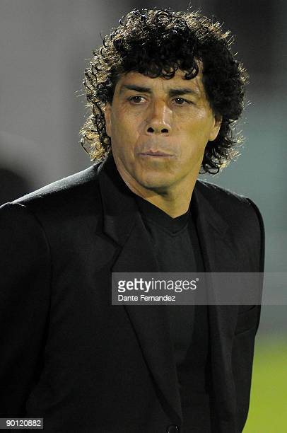 Bolivia's Blooming head coach Victor Hugo Andrada watches his players during their match against Uruguay's River Plate as part of the Copa Nissan...