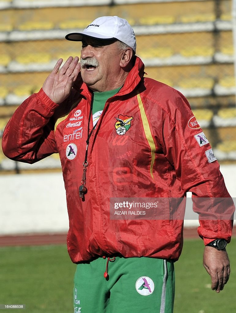 Bolivia's coach Spaniard Xabier Azcargorta, gives orders to the players in a training session of the Bolivian national football team in La Paz on March 19, 2013. Bolivia will face Colombia on march 22 and Argentina on march 26 in matches of the Brazil 2014 FIFA World Cup South American qualifier.