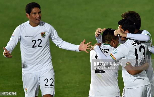 Bolivia's defender Edward Zenteno Bolivia's defender Miguel Angel Hurtado and Bolivia's midfielder Damir Miranda celebrate with teammates after their...