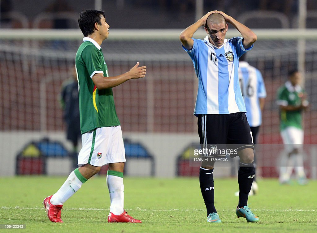 Bolivia's defender Stalin Taborga (L) comforts Argentina's midfielder Ricardo Centurion at the end of their Group A South American U-20 qualifier football match at Malvinas Argentinas stadium in Mendoza, Argentina, on January 13, 2013. Four teams will qualify for the FIFA U-20 World Cup Turkey 2013.