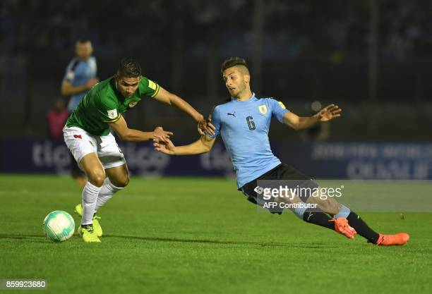 Bolivia's Diego Bejarano vies for the ball with Uruguay's Rodrigo Bentancur during their 2018 World Cup football qualifier match in Montevideo on...