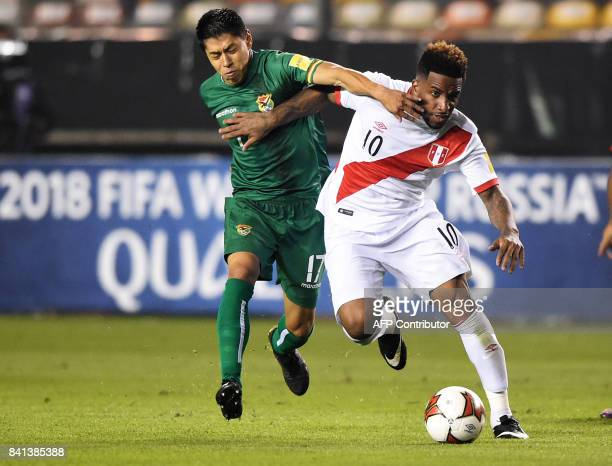 Bolivia's Diego Wayar vies for the ball with Peru's Jefferson Farfan during their 2018 World Cup qualifier football match in Lima on August 31 2017 /...