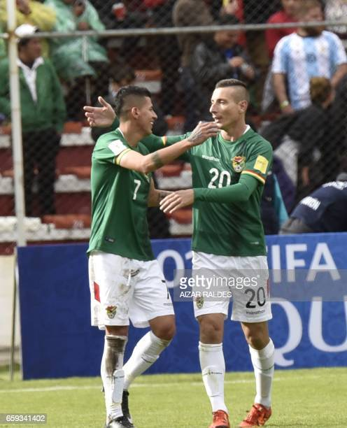 Bolivia's forward Juan Arce celebrates with Pablo Escobar after scoring against Argentina during their 2018 FIFA World Cup qualifier football match...