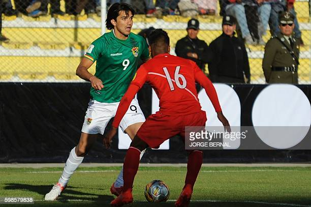 Bolivia's forward Marcelo Martins and Peru's midfielder Pedro Aquino vie for the ball during the Russia 2018 World Cup qualifier football match at...