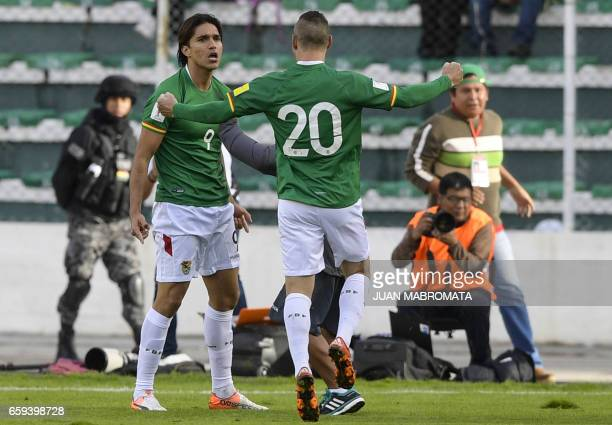 Bolivia's forward Marcelo Martins celebrates with teammate Pablo Escobar after scoring the team's second goal against Argentina during a 2018 FIFA...