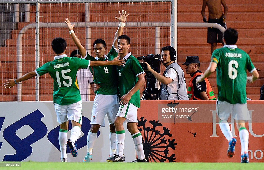 Bolivia's forward Rodrigo Vargas (2-L) celebrates with teammates after scoring against Argentina during their Group A South American U-20 qualifier football match at Malvinas Argentinas stadium in Mendoza, Argentina, on January 13, 2013. Four teams will qualify for the FIFA U-20 World Cup Turkey 2013.