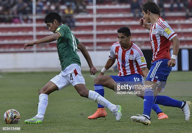 Bolivia's Gabriel Valverde Paraguay's Cecilio Dominguez and Paraguay's Oscar Romero vie for the ball during their 2018 FIFA World Cup qualifier...