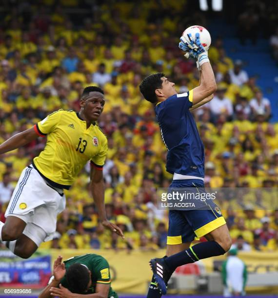 Bolivia's goalkeeper Carlos Lampe grabs the ball in front of Colombia's defender Yerry Mina during their 2018 FIFA World Cup qualifier football match...