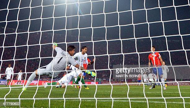 Bolivia's goalkeeper Romel Quinonez dives trying to stop the ball after Charles Aranguiz shot during their 2015 Copa America football championship...