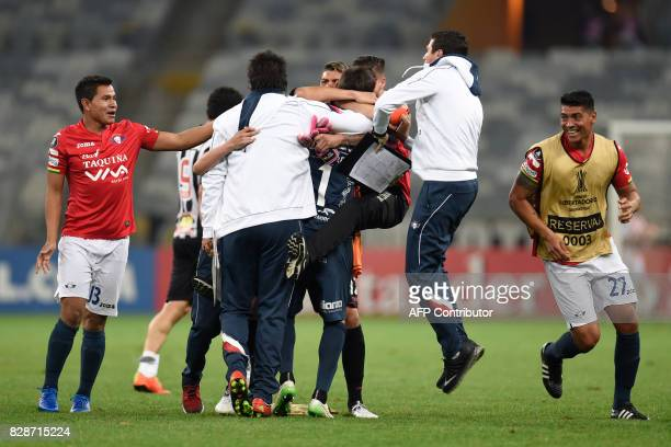 Bolivia's Jorge Wilstermann players celebrate after their team qualified in the end of a Copa Libertadores football match against Brazil's Atletico...