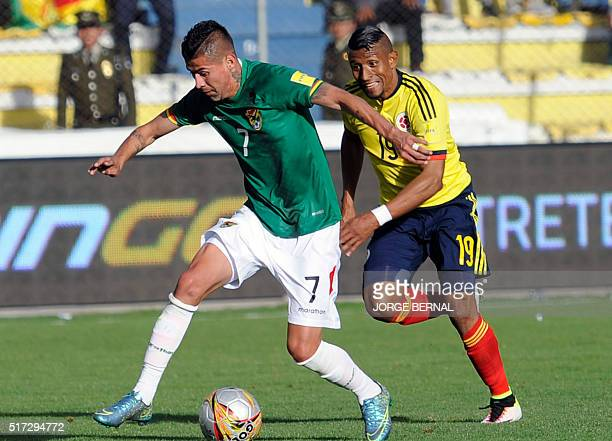 Bolivia's Juan Carlos Arce and Colombia's Farid Diaz vie for the ball during their Russia 2018 FIFA World Cup South American Qualifiers' football...