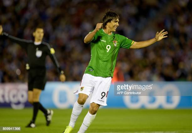 Bolivia's Marcelo Martins celebrates after Uruguay scored an own goal during their 2018 World Cup football qualifier match in Montevideo on October...