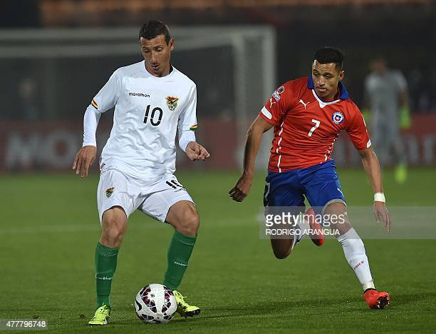 Bolivia's midfielder Pablo Escobar is challenged by Chile's forward Alexis Sanchez during their 2015 Copa America football championship match in...