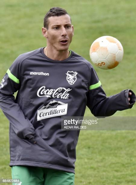Bolivia's national football team player Pablo Escobar eyes the ball during a training session in La Paz on March 18 2017 ahead of their South...