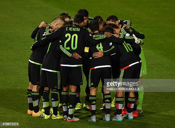 Bolivia's national team footballers gather before the start of their Copa America football match against Mexico in Vina del Mar Chile on June 12 2015...
