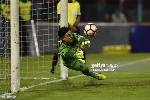 Bolivia's Oriente Petrolero goalkeeper Guillermo Viscarra block a penalty kick against Deportivo Cuenca from Ecuador during their 2017 Copa...