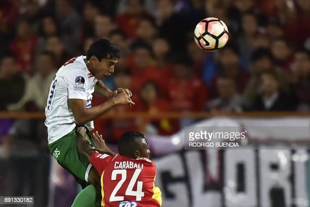 Bolivia's Oriente Petrolero player Diego Suarez vies for the ball with Ecuador's Deportivo Cuenca Bryan Carabali during their 2017 Copa Sudamericana...