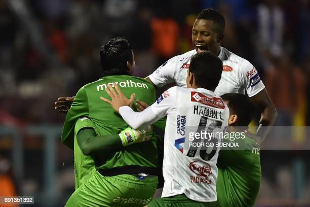 Bolivia's Oriente Petrolero players celebrate a victory against Deportivo Cuenca from Ecuador during their 2017 Copa Sudamericana football match at...
