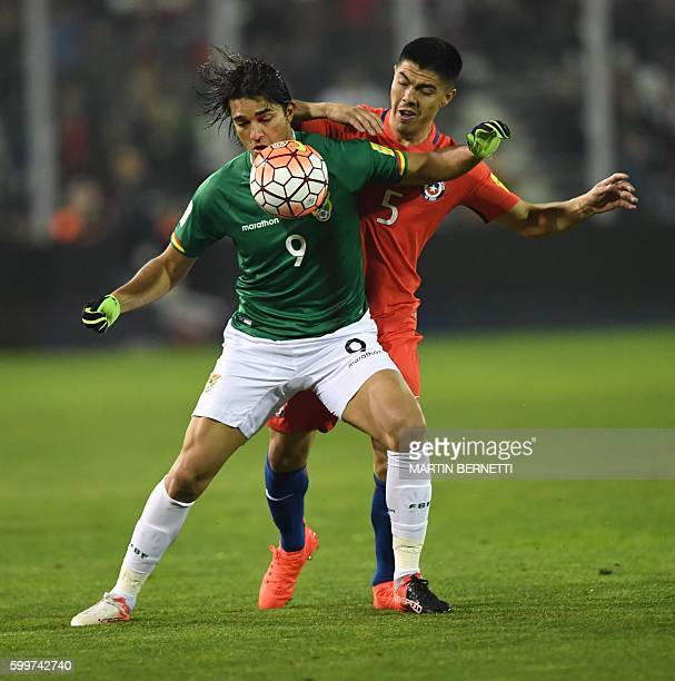 Bolivia's Pablo Escobar and Chile's midfielder Francisco Silva vie for the ball during their Russia 2018 FIFA World Cup football qualifier match...