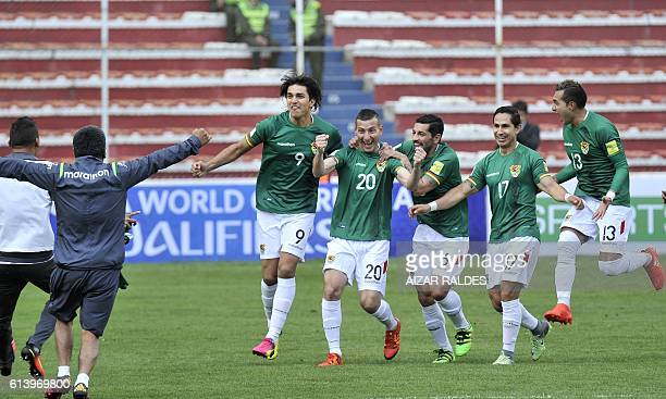 Bolivia's Pablo Escobar celebrates with teammates after scoring against Ecuador during their Russia 2018 FIFA World Cup qualifier football match in...