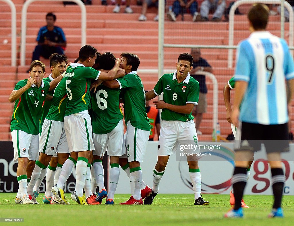 Bolivia's players celebrate after scoring against Argentina during their Group A South American U-20 qualifier football match at Malvinas Argentinas stadium in Mendoza, Argentina, on January 13, 2013. Four teams will qualify for the FIFA U-20 World Cup Turkey 2013.
