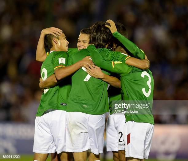 Bolivia's players celebrate after Uruguay scored an own goal during their 2018 World Cup football qualifier match in Montevideo on October 10 2017 /...