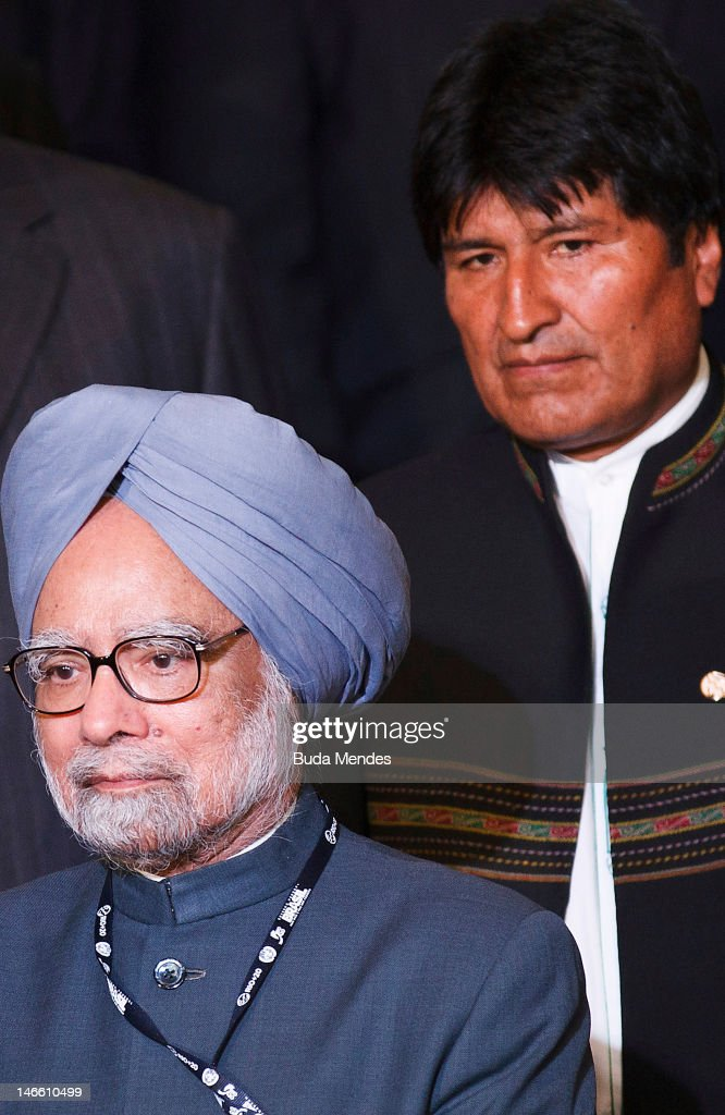 Bolivia's President <a gi-track='captionPersonalityLinkClicked' href=/galleries/search?phrase=Evo+Morales&family=editorial&specificpeople=272981 ng-click='$event.stopPropagation()'>Evo Morales</a> (back) and India's Prime Minister <a gi-track='captionPersonalityLinkClicked' href=/galleries/search?phrase=Manmohan+Singh&family=editorial&specificpeople=227120 ng-click='$event.stopPropagation()'>Manmohan Singh</a> pose during the UN Conference on Sustainable Development Rio+20 family photo, on June 20, 2012 in Rio de Janeiro, Brazil.