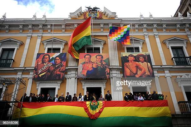 Bolivia's President Evo Morales and Vicepresident Alvaro Garcia Linera accompanied by their official guests appear on a balcony to greet the crowd...