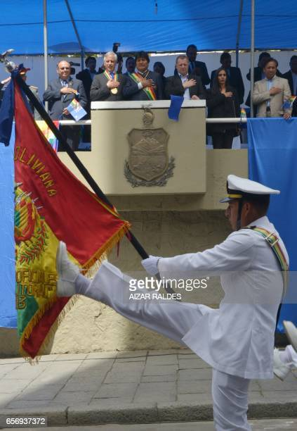 Bolivia's President Evo Morales Ayma observes from the presidential box the civilmilitary parade during the ceremony that marks the 138th anniversary...