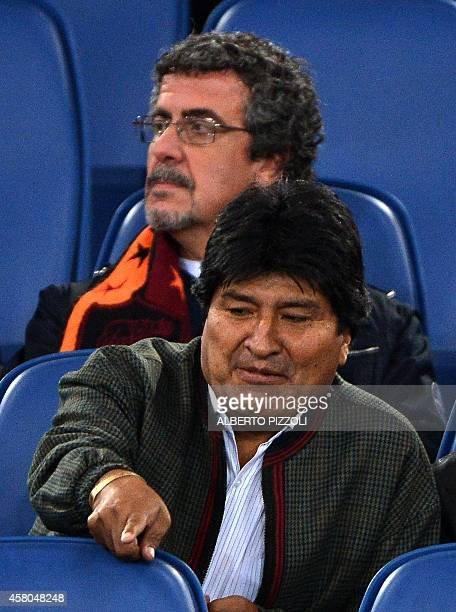 Bolivia's President Evo Morales is pictured in the stands before the Italian Serie A football match As Roma vs Cesena on October 29 2014 at the...