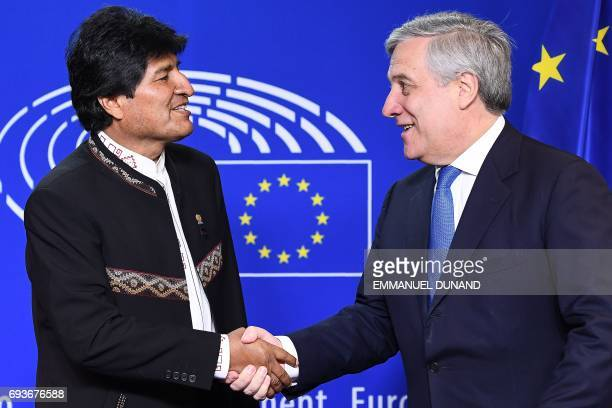 Bolivia's President Evo Morales shakes hands with European Parliament President Antonio Tajani at the European Parliament in Brussels on June 8 2017...