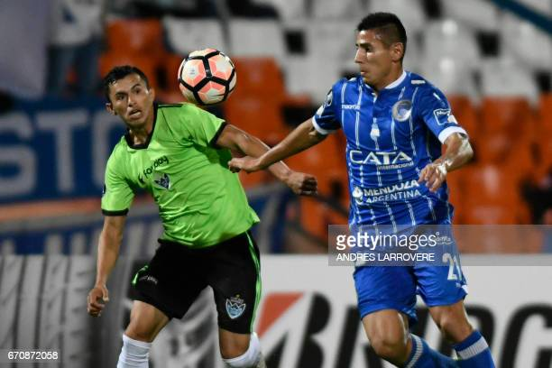 Bolivia's Sport Boys Juan Carlos Zampiery vies for the ball with Fabrizio Angileri of Argentina's Godoy Cruz during their Copa Libertadores 2017...