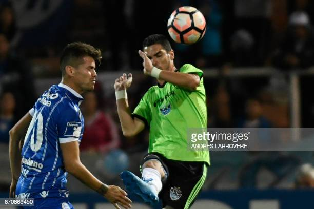 Bolivia's Sport Boys player Leandro Ferreira vies for the ball with Gaston Gimenez of Argentina's Godoy Cruz during their Copa Libertadores 2017...