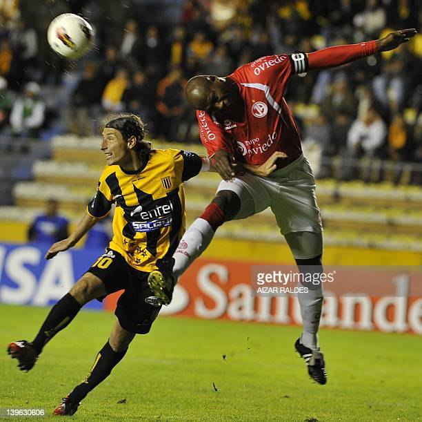 Bolivia's The Strngest Pablo Escobar vies for the ball with Luis Guadalupe Juan Aurich of Peru during their Copa Libertadores football match at...