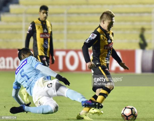 Bolivia's The Strongest player Alejandro Chumacero vies for the ball with Irven Avila of Peru's Sporting Cristal during their Copa Libertadores...