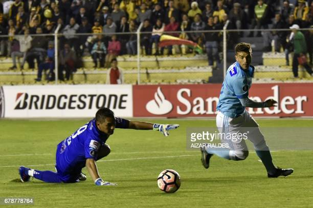 Bolivia's The Strongest player Daniel Vaca vies for the ball with Horacio Martin Calcaterra of Peru's Sporting Cristal during their Copa Libertadores...