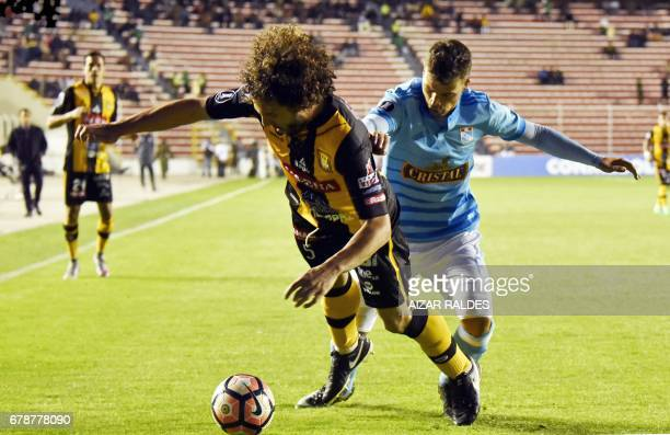Bolivia's The Strongest player Fernando Marteli vies for the ball with Gabriel Costa Heredia of Peru's Sporting Cristal during their Copa...