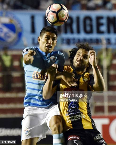 Bolivia's The Strongest player Fernando Marteli vies for the ball with Irven Beybe Avila Acero of Peru's Sporting Cristal during their Copa...