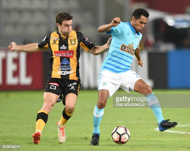 Bolivias The Strongest player Matias Alonso vies for the ball with Peru's Sporting Cristal player Martin Tabara during their Copa Libertadores match...