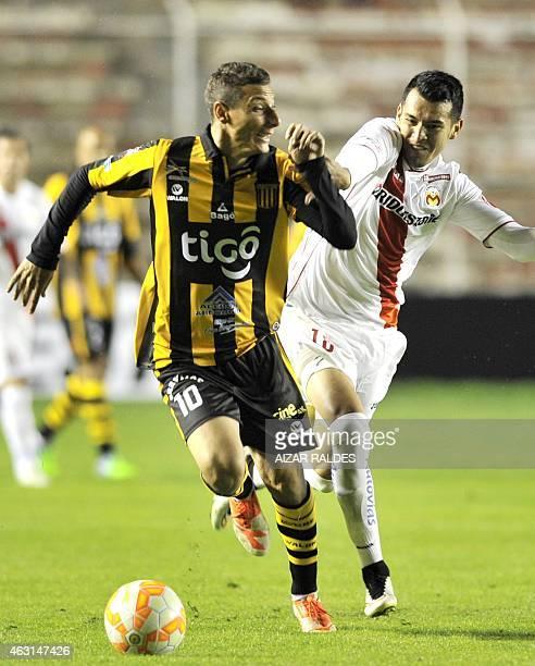 Bolivia's The Strongest player Pablo Escobar vies for the ball with Mexico's Morelia player Daniel Arreola during their Copa Libertadores football...
